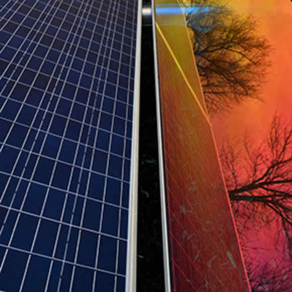Close up of solar panels reflecting the sky and trees
